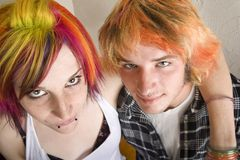 Young Couple with Bright Colored Hair Embrace stock photography