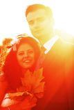 Young couple at bright sunset Royalty Free Stock Images