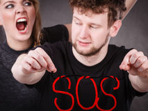Young couple with broken heart and sos word. Stock Photo