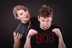 Young couple with broken heart and sos word. Stock Images