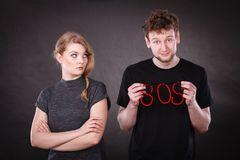 Young couple with broken heart and sos word. Stock Photos