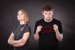 Young couple with broken heart and sos word. Royalty Free Stock Image