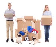 young couple with brown cardboard boxes with stuff and dogs isolated on white royalty free stock image