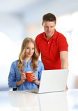 Young couple  browsing on computer Stock Photography