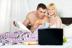 Young couple browsing the internet Stock Images