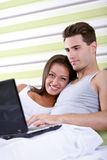 Young couple browsing the internet Royalty Free Stock Image