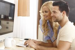 Young couple browsing Internet at home Stock Images