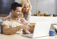 Young couple browsing internet at home Royalty Free Stock Photos
