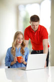 Young couple browsing together on a laptop Stock Photo
