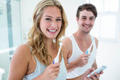 Young couple brushing their teeth at home Stock Photography