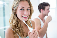 Young couple brushing their teeth at home Stock Images