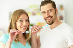 Young couple brushing their teeth Stock Photo