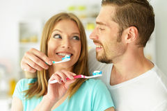 Young couple brushing their teeth Stock Images