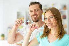 Young couple brushing their teeth Royalty Free Stock Images