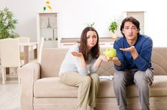 The young couple in budget planning concept. Young couple in budget planning concept stock photography
