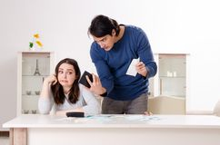 The young couple in budget planning concept. Young couple in budget planning concept royalty free stock photography