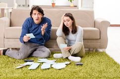 The young couple in budget planning concept. Young couple in budget planning concept stock photo