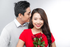 Young couple with bunch of roses Royalty Free Stock Images