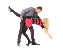 Young couple in business clothes on dancing pose Royalty Free Stock Photography