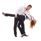 Young couple in business clothes on dancing pose Royalty Free Stock Photo