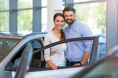 Young couple buying a car Stock Image