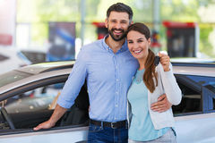 Young couple buying a car Royalty Free Stock Photo