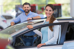 Young couple buying a car Stock Images