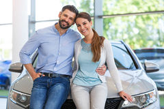 Young couple buying a car Royalty Free Stock Photography