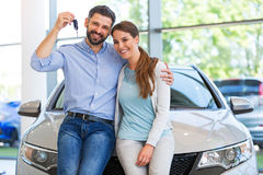 Young couple buying a car Stock Photos