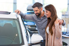 Young couple buying a car Stock Photography