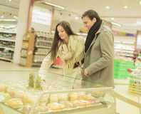 Young couple buying fruits Stock Images