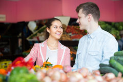 Young couple buying fruits in market Stock Photo