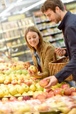 Young couple buying groceries Stock Image