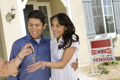 Young couple buying house taking keys Royalty Free Stock Photo