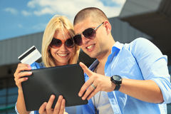 Young couple buying on internet Stock Images
