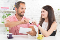 A young couple buying on internet Royalty Free Stock Photo