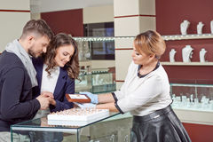 Young couple buying jewelry Royalty Free Stock Images