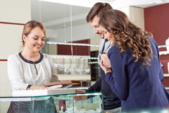 Young couple buying jewelry Royalty Free Stock Photography