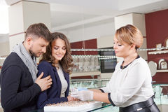 Young couple buying jewelry Royalty Free Stock Photo