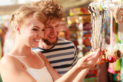Young couple buying souvenirs outdoor Royalty Free Stock Images
