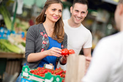 Young couple buying at street market Royalty Free Stock Photos