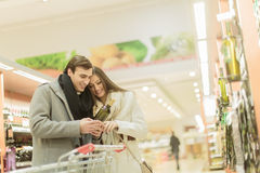 Young couple buying wine Stock Photo