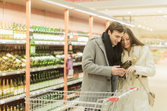 Young couple buying wine Stock Photography