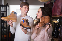Young couple buying winter shoes Royalty Free Stock Photography
