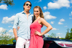Young couple with cabriolet in summer on day trip Stock Photos