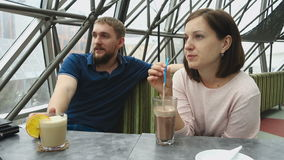 Young couple in cafe stock video footage