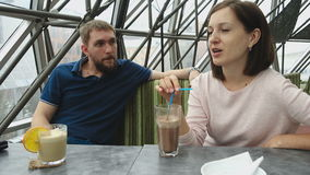 Young couple in cafe stock video