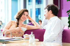 Young couple cafe drinking coffee Royalty Free Stock Photos