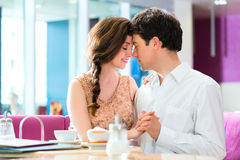 Young couple cafe hugging and kissing Royalty Free Stock Photography