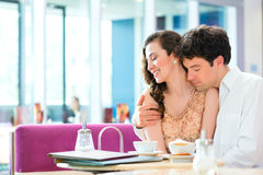 Young couple cafe hugging and kissing Stock Photography